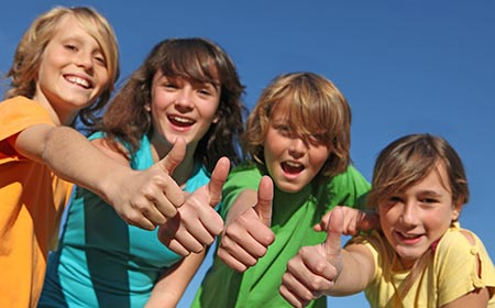 bigstock-Group-Of-Tweens-With-Thumbs-Up-4782253
